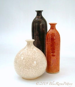Image of Group of three Luster bottles