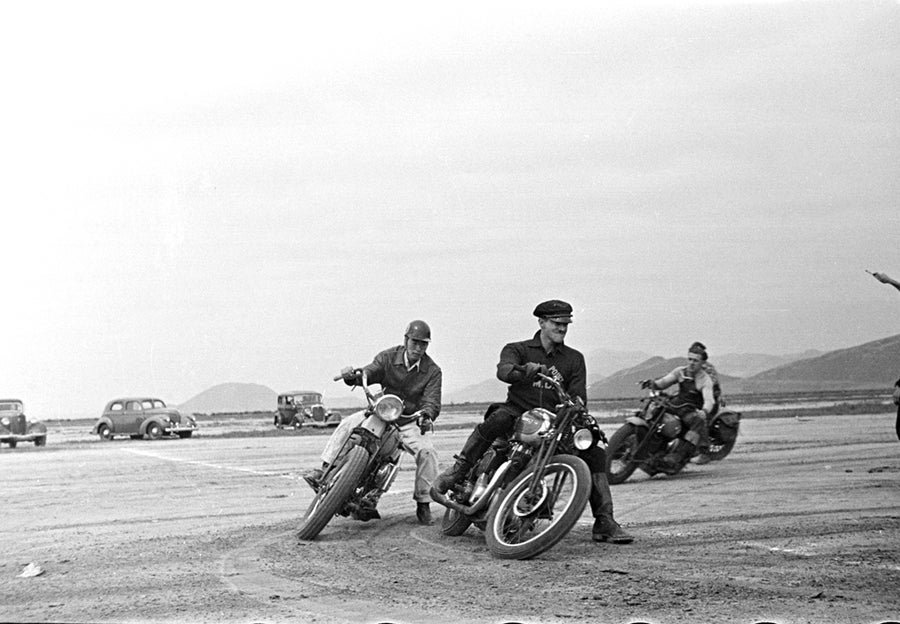 Image of Bikers Race In The Desert