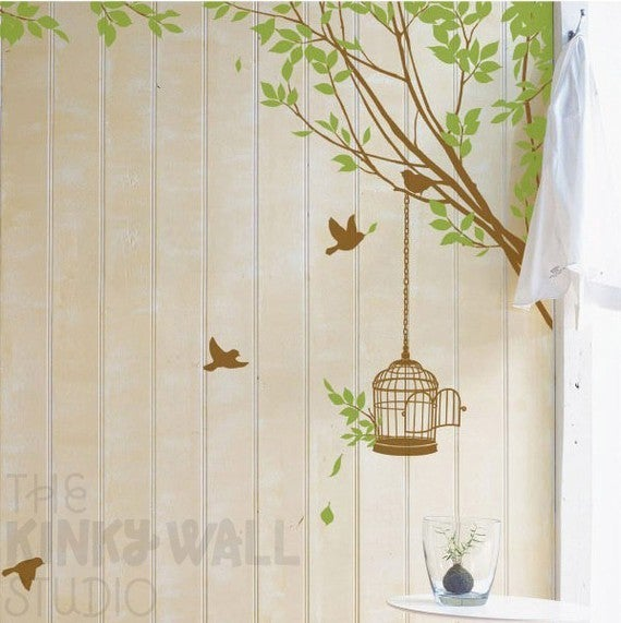 bird cage hanging off tree branch with birds wall decal