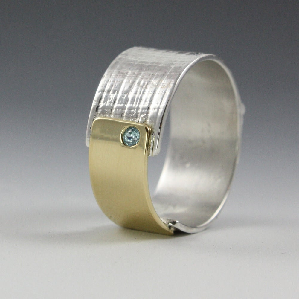 Image of sterling silver and 18k gold papyrus ring with blue zircon stone
