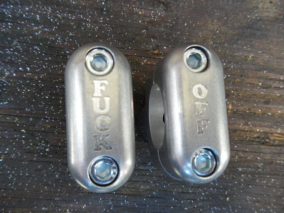 Image of Fuck  Aluminum risers for triple clamps.
