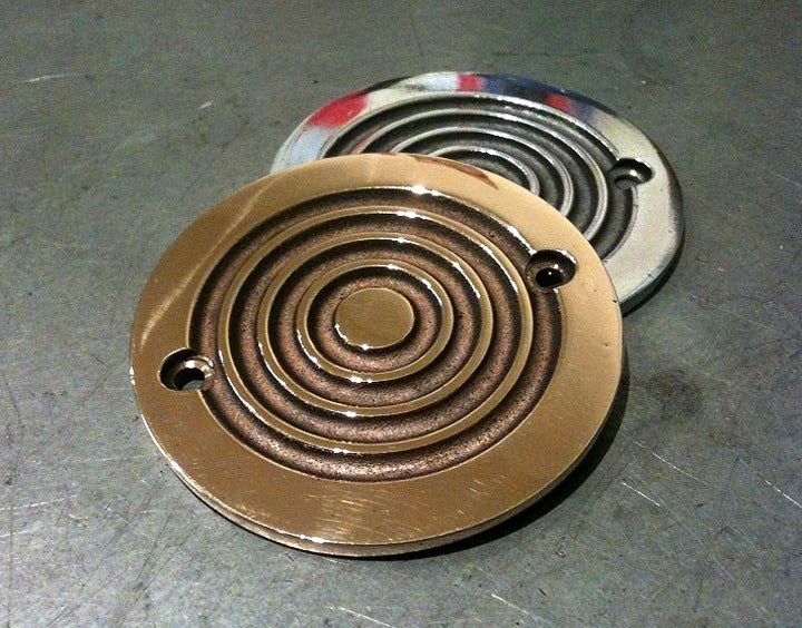 "Image of Old Gold ""Bullseye"" ignition covers"
