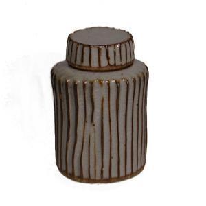 Image of carved covered jar