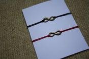 Image of 'Infinite Love' Bracelet on Waxed Cotton