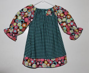Image of Houndstooth Prairie Dress with matching flower pin