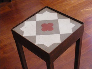 Image of Red flower plant stand