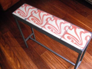 Image of Swirly red on light grey console
