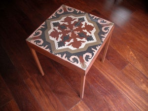 Image of End table: Pink, Soft red, Soft green on off white. Version I
