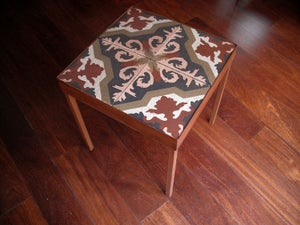 Image of End table: Pink, Soft red, Soft green on off white. Version II