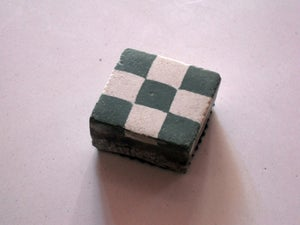 Image of Green checkerboard paperweight