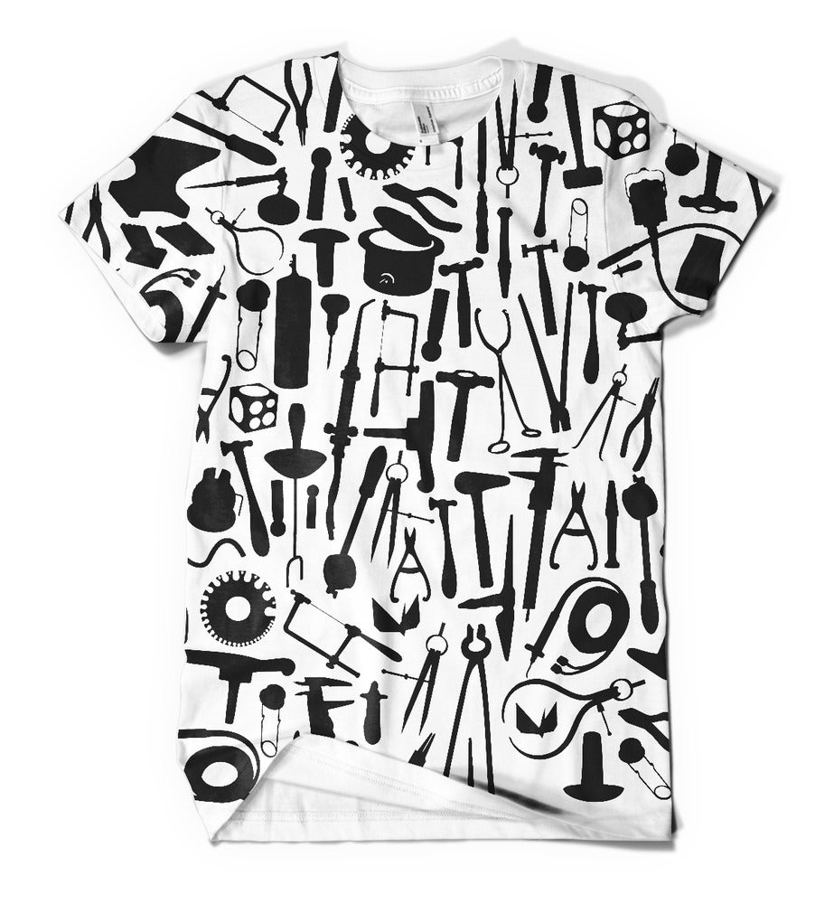 Image of Metals tools: black tools on white shirt (misprint) slight ghosting