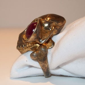 """Image of """"Edgar"""" Brass with Ruby Cabachon Eyes"""