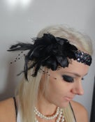 Image of 1920s black feather flapper headband races