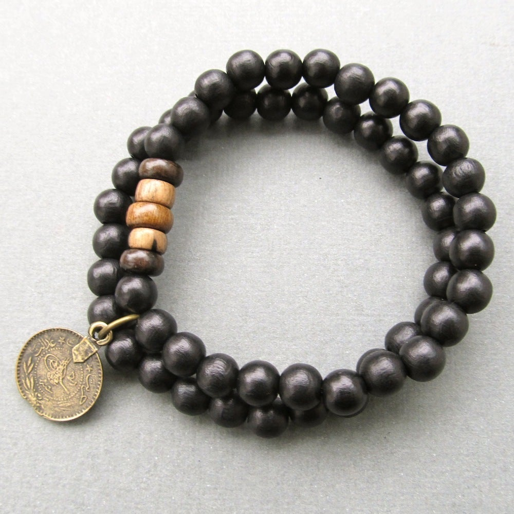 Image of Double black beaded stretch bracelet with coin charm
