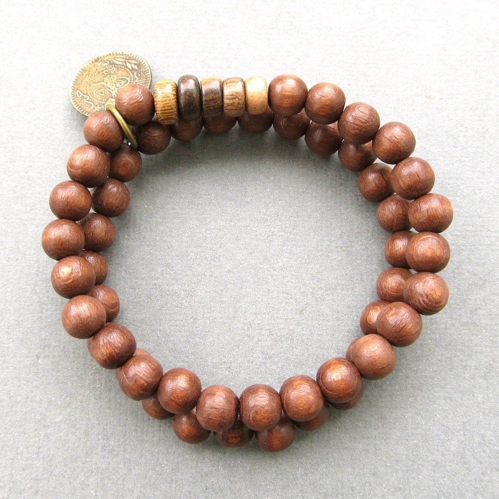 Image of Double brown beaded stretch bracelets with coin charm