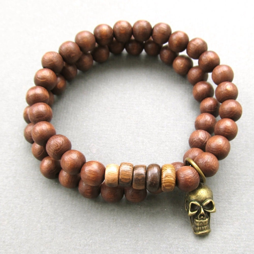 Image of Double brown beaded stretch bracelets with skull charm