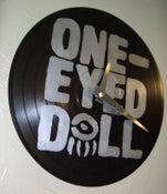 Image of One-Eyed Doll xDM - Silver Logo on Black 10inch - Custom Record Clock