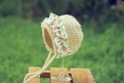 Image of Dark Cream Girls Bonnet with Pink Floral Ruffles