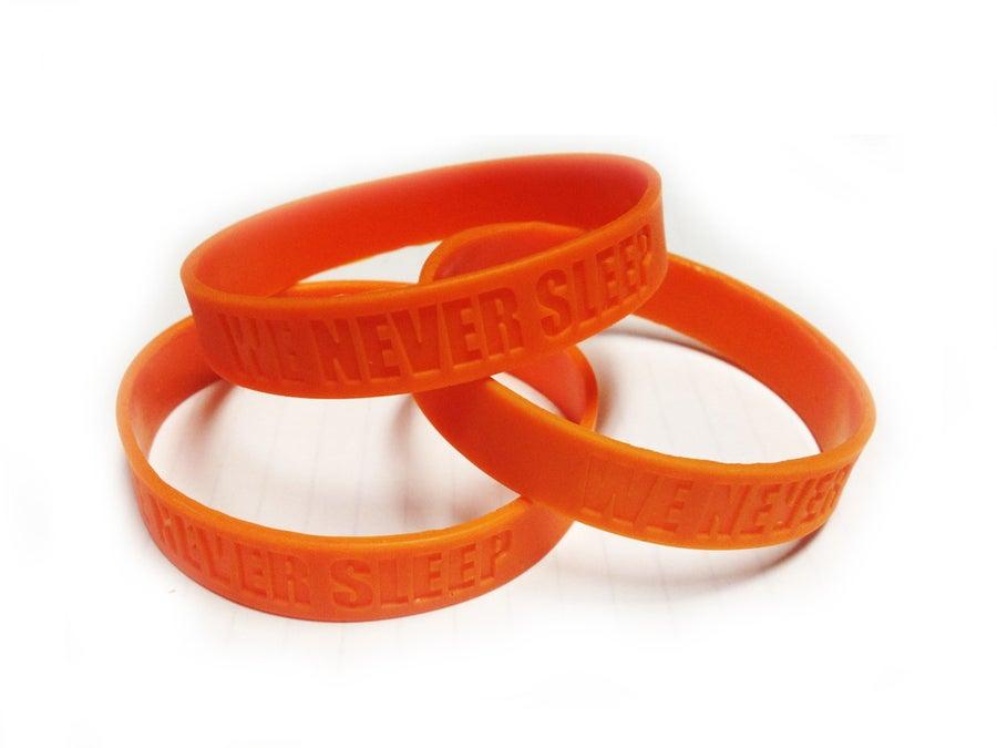 Image of We Never Sleep Wirst Band - Orange