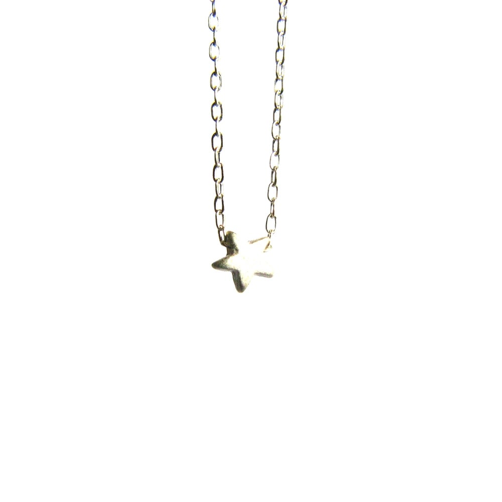 Image of Tiniest sterling silver star necklace