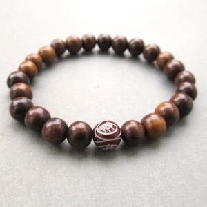 Image of Mens brown robles beaded stretch bracelet with chinese serpentine bead