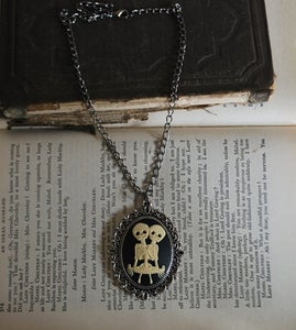 Image of CONJOINED SIAMESE TWINS SKELETON SKULLS LARGE ornate Cameo NECKLACE GOTH HORROR