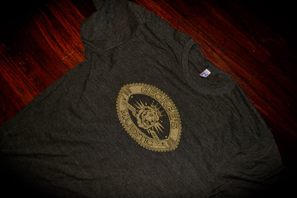 Image of gold lion tee