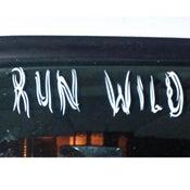 "Image of Run Wild White Vinyl Decal Size 10"" x 2.5"""