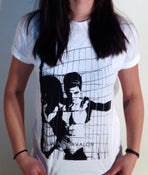 Image of Girl in cage t-shirt