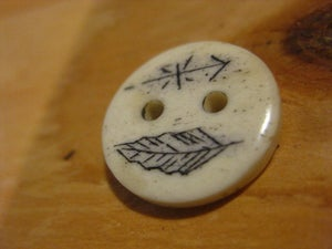 Image of scrimshaw cow bone button