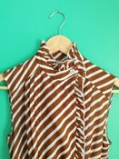 Image of Brown & white striped dress with peplum & pleats