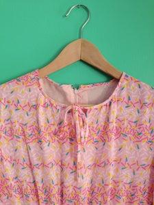 Image of Pink confetti print dress.