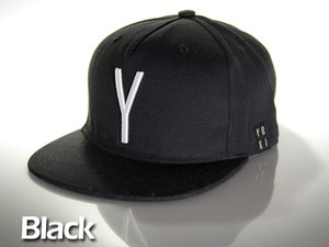 Image of Black snap back cap