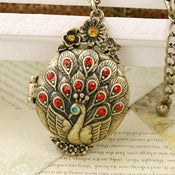 Image of Peacock Brass Locket Box - Charming Red Opening Pendant Gift
