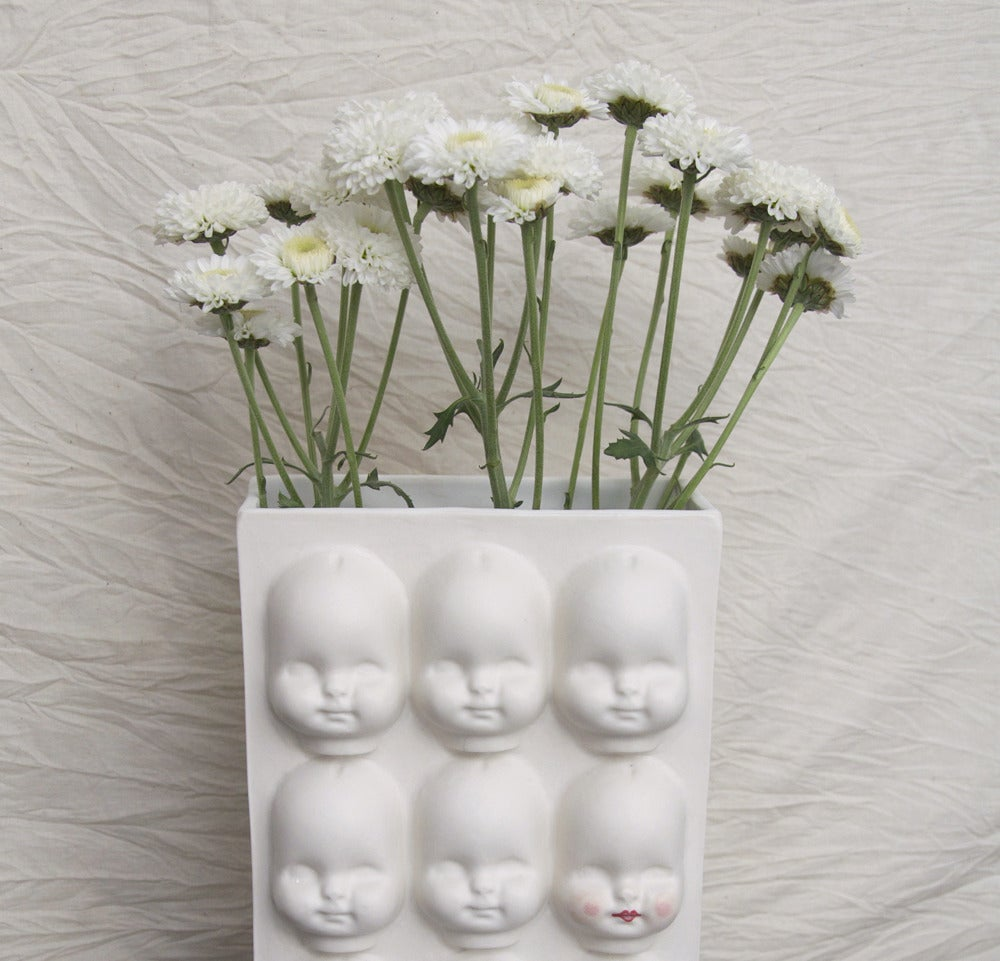 Image of double sided doll face