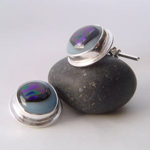 Image of eccentrics glass and sterling cufflinks