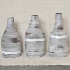 Image of roughed up bud vases