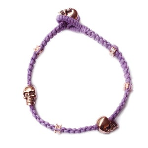 Image of 'Don't lose your head' bracelet, Bitten lip lavender with rose gold skulls