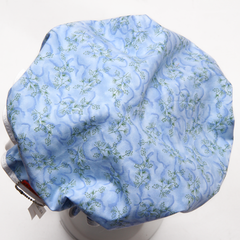 Image of Showercap pale blue with green sprigs - big size