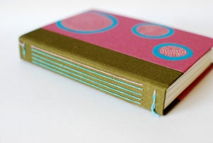 Image of magenta circles work book - vertical - blank pages