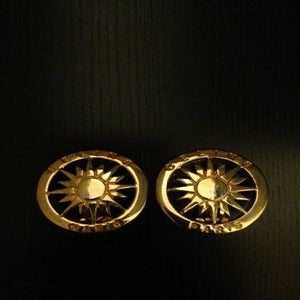 Image of Vintage Celine Gold Circular Sun Logo Clip-on Earrings