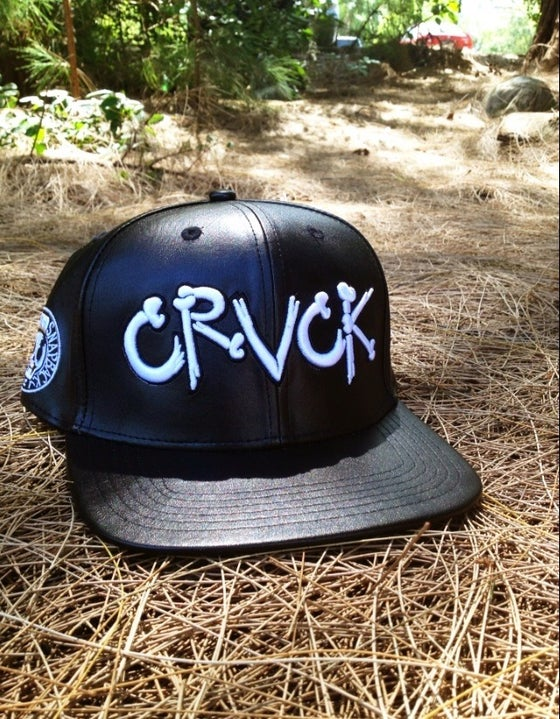 """Image of Crvck """"Crvck Bones"""" Black Leather StrapBack."""