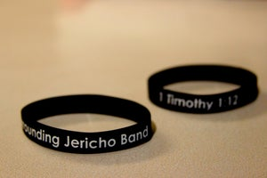 Image of Black w/ White lettering Wristband
