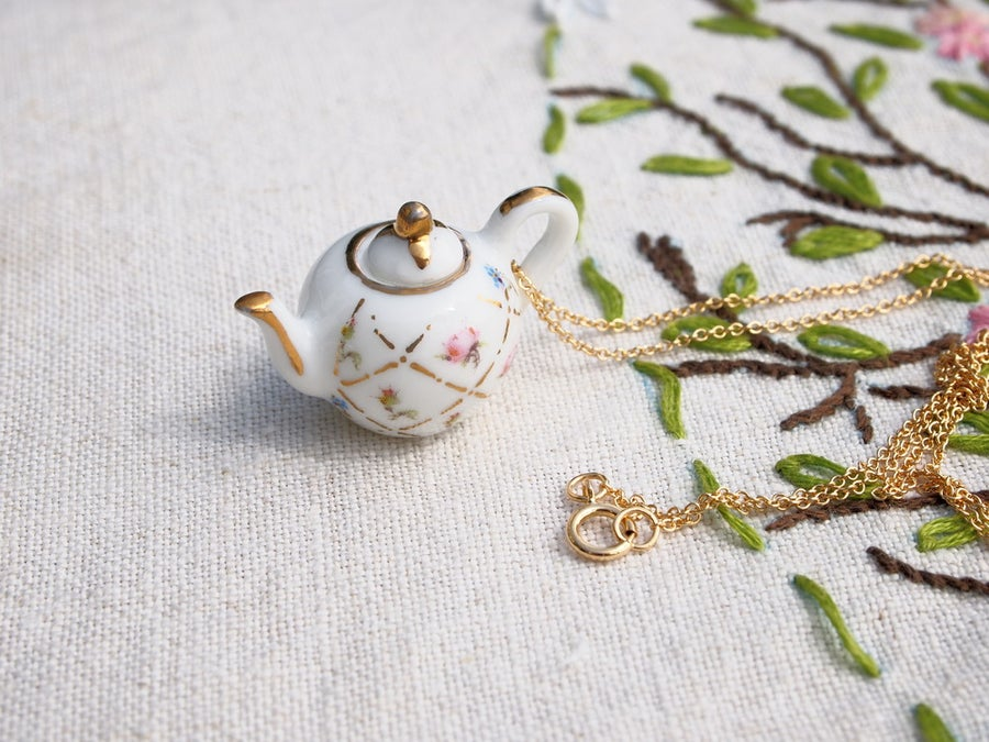 Image of gold lattice teapot necklace