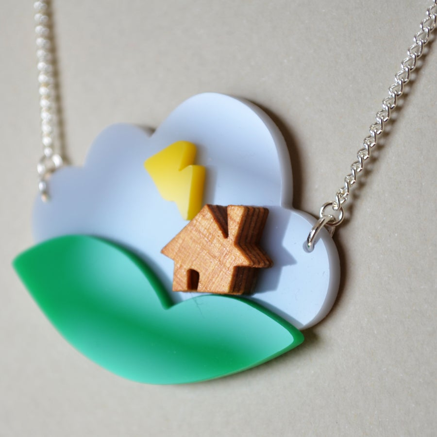 i am acrylic house in a necklace