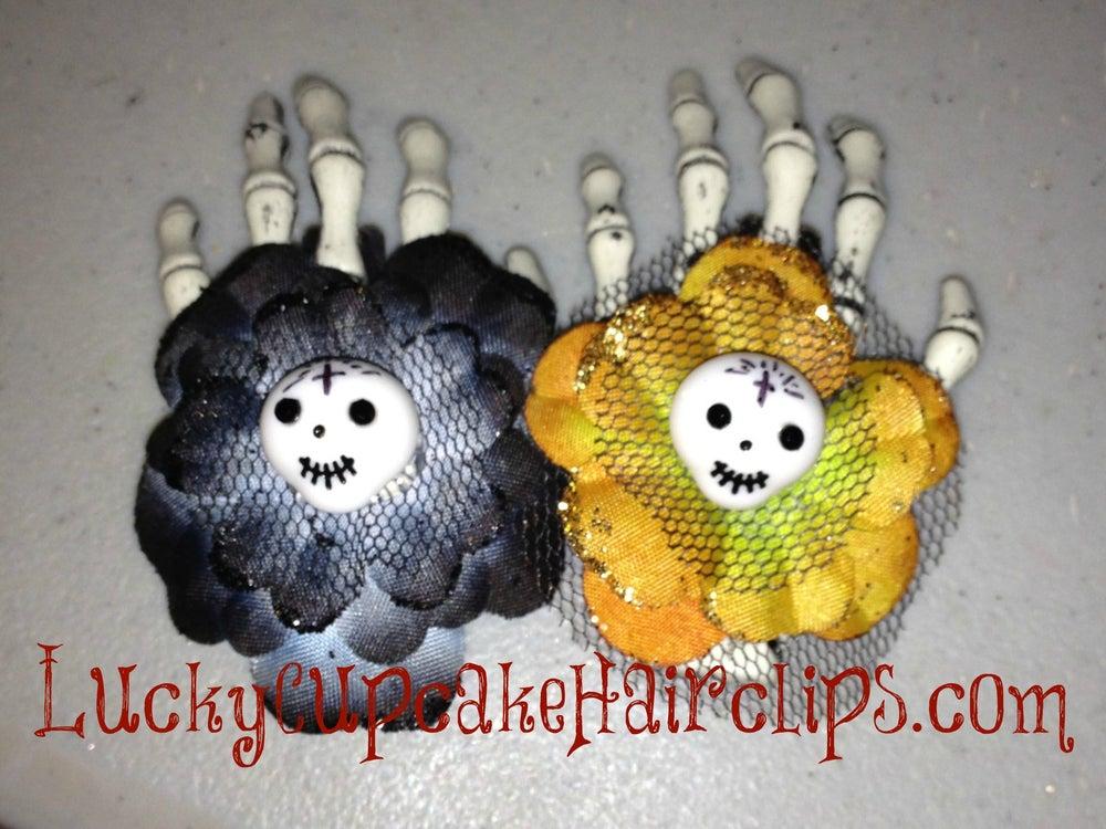 Image of Skelly Flower Hands.