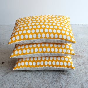 Image of reverse dotty golden yellow cushions