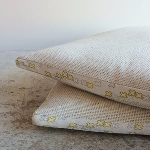 Image of textured linen with cross dotty cushions