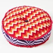 Image of Orange 'Wave' round cushion
