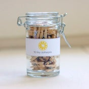Image of Tiny Clothespins in a Jar
